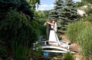 wedding bridge kiss